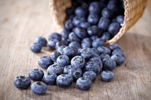 blueberries-rolling-out-of-basket