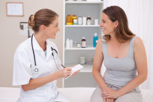 female-patient-doctor-chatting-happy