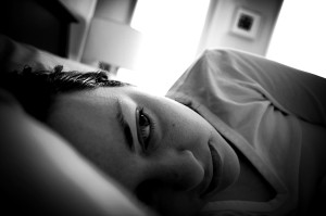 woman-lying-in-bed-black-white