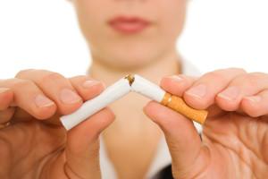 woman-breaks-cigarette-quit