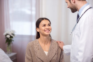 young-woman-doctor-consultation-hand-shoulder
