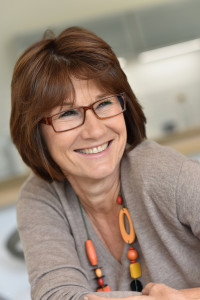 woman-middle-aged-glasses-smiling