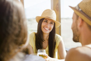woman-drinking-beer-wearing-hat