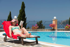 summertime-woman-relaxed-by-pool