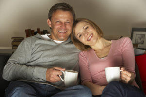 couple-on-couch-with-coffee