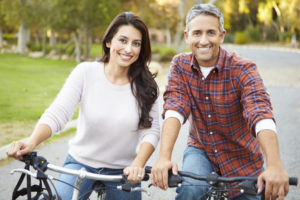 couple-in-park-on-bicycles