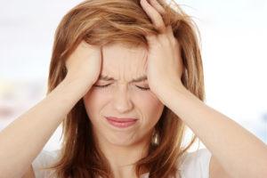 young-woman-headache-symptom