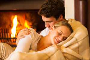 couple-snuggling-by-fire-intimacy