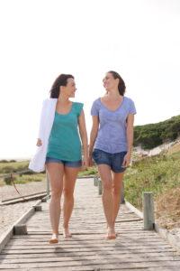 girlfriends-walking-wooden-trail