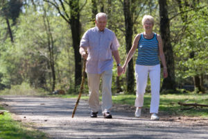 senior-couple-walking-happy