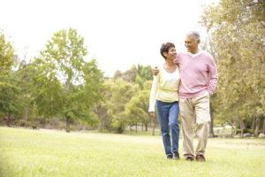 senior-couple-walking-in-park