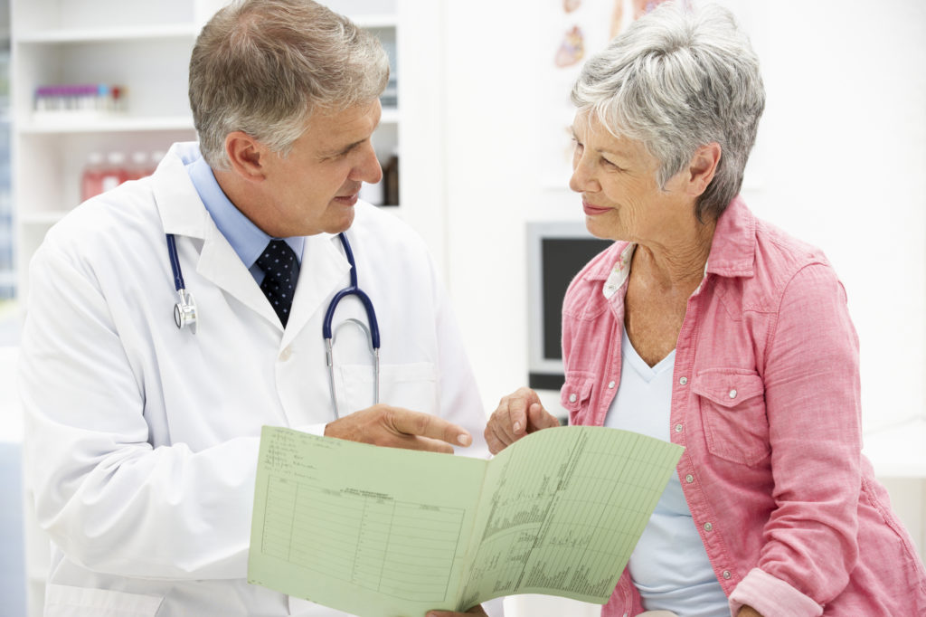 Doctor with older female patient